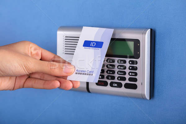 Person Holding Key Card Near Security System Stock photo © AndreyPopov