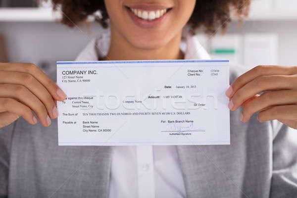 Femme d'affaires chèque bureau affaires main Photo stock © AndreyPopov