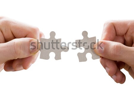 Human Hand Holding Jigsaw Puzzle Stock photo © AndreyPopov