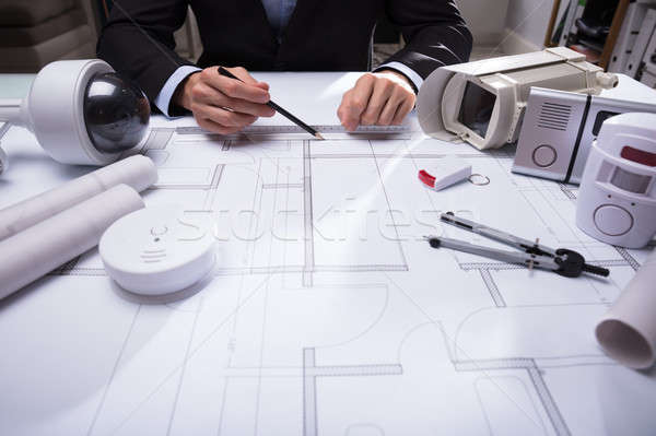 Close-up Of An Architect's Hand Drawing Blueprint Stock photo © AndreyPopov