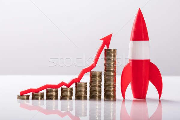 Közelkép piros rakéta egymásra pakolva érmék nyíl Stock fotó © AndreyPopov