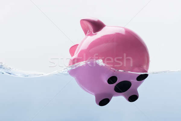 Piggy Bank Drowning In Water Stock photo © AndreyPopov