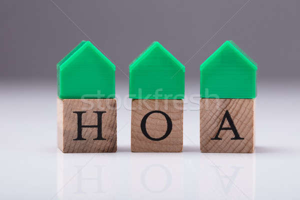 Close-up Of House Model Over Wooden Block Stock photo © AndreyPopov