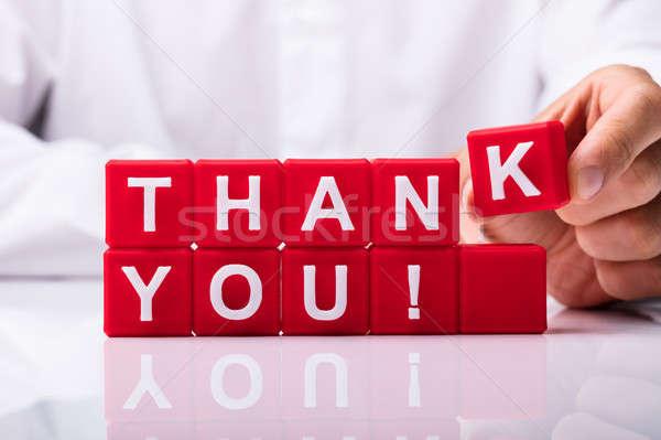 Személy készít köszönjük szöveg piros kockák Stock fotó © AndreyPopov