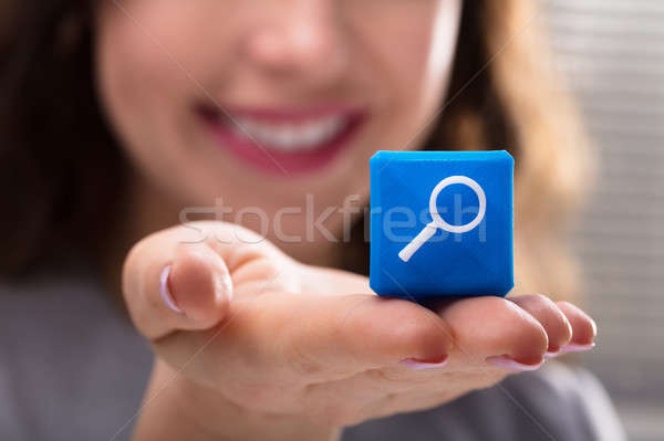 Woman Holding Cubic Block With Magnifying Glass Icon Stock photo © AndreyPopov