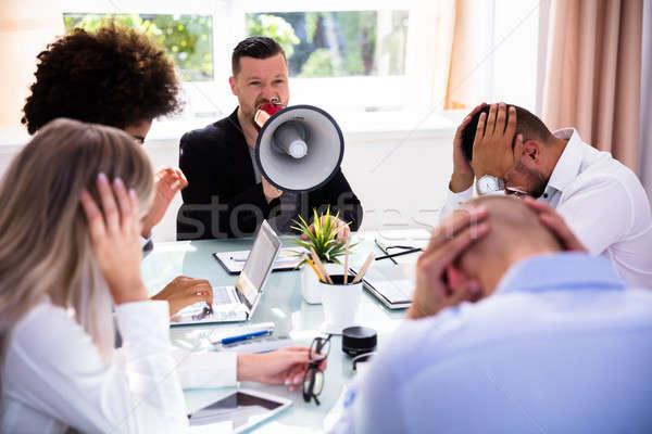 Enojado empresario megáfono colegas negocios Foto stock © AndreyPopov