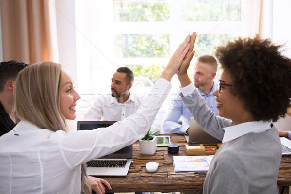 Two Businesswomen Giving High Five Stock photo © AndreyPopov