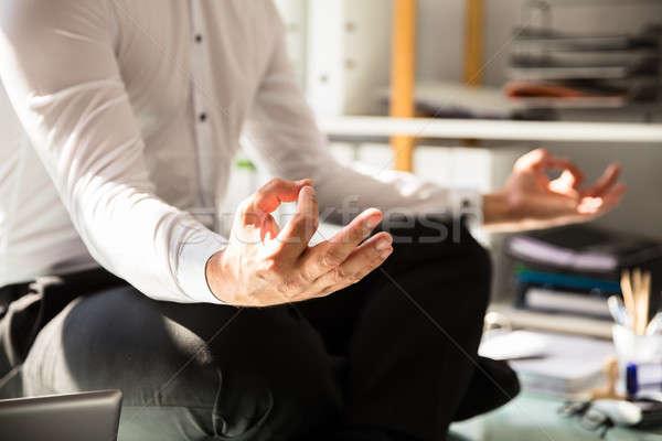 Businessman doing yoga Stock photo © AndreyPopov