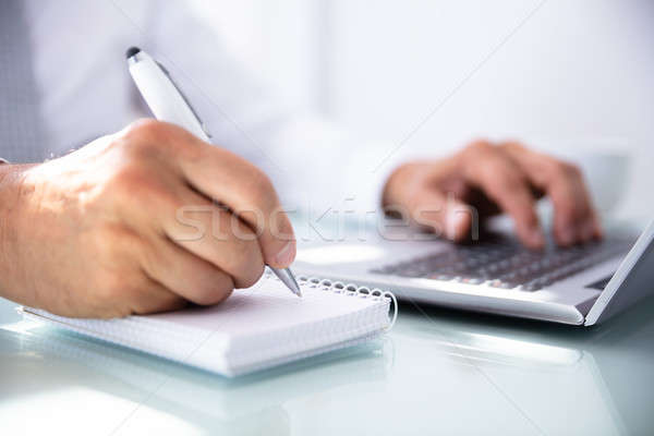 Businessman's Hand Writing In Diary Stock photo © AndreyPopov