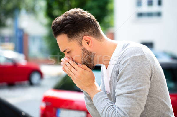 Man Coughing At Outdoor Stock photo © AndreyPopov