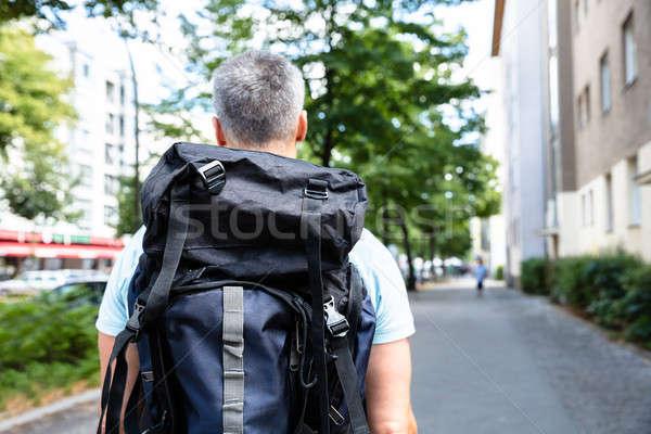 вид сзади человека ходьбе тротуар рюкзак здании Сток-фото © AndreyPopov