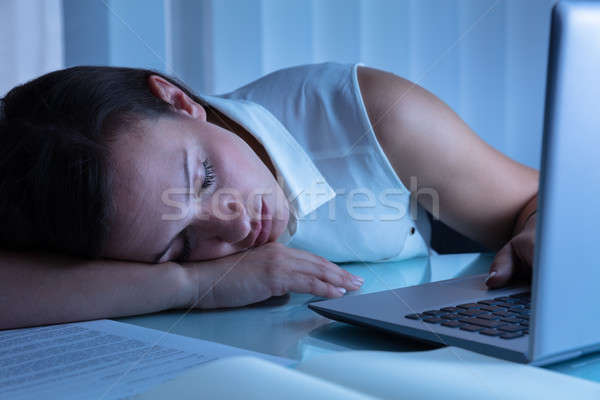 Businesswoman Napping In Office Stock photo © AndreyPopov