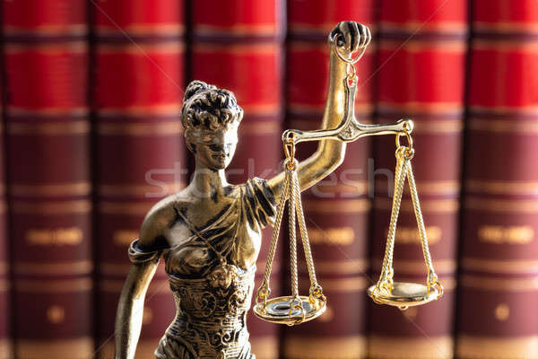 Justice Statue In Front Of Red Law Books Stock photo © AndreyPopov