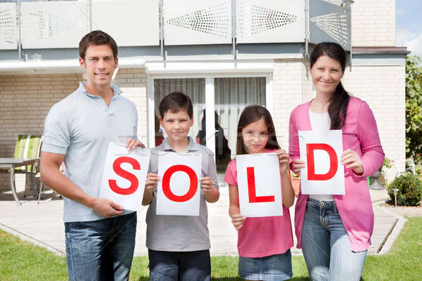 Family holding a sold sign outside their home Stock photo © AndreyPopov