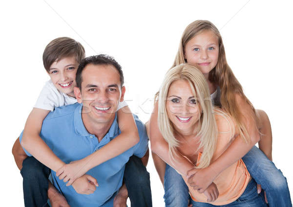 Couple Giving Two Young Children Piggyback Rides Stock photo © AndreyPopov