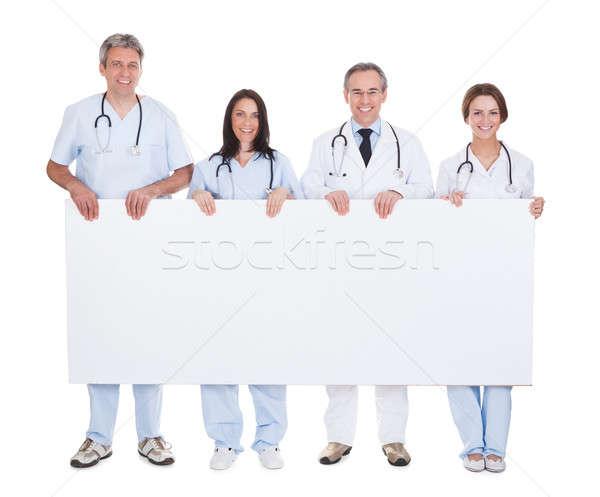 Csoport orvos tart plakát boldog áll Stock fotó © AndreyPopov