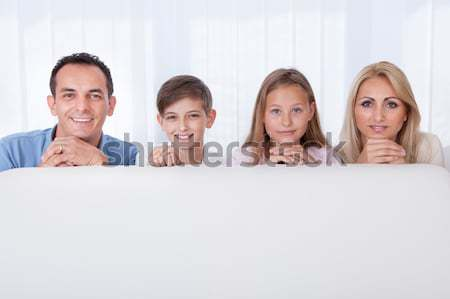Happy friendly family relaxing Stock photo © AndreyPopov