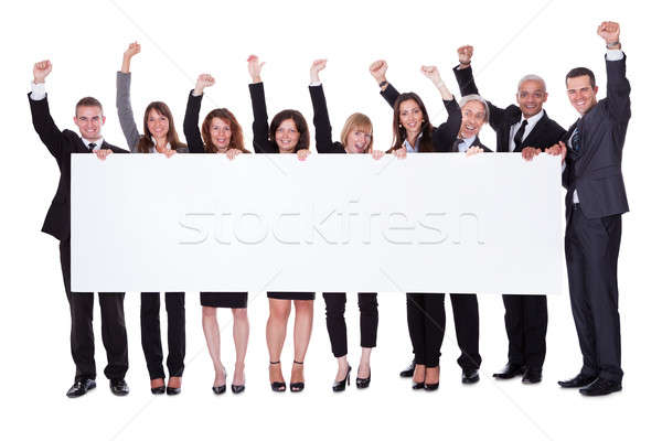 Stock photo: Group of business people with a blank banner