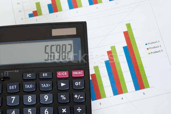 Photo of calculator and growth charts Stock photo © AndreyPopov