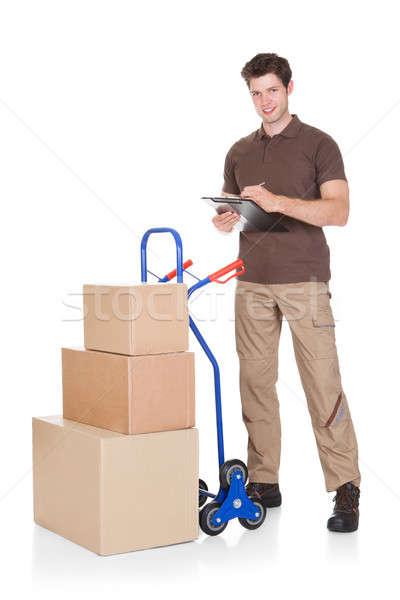 Foto stock: Clipboard · caixas · jovem