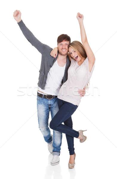 Happy young couple celebrating Stock photo © AndreyPopov