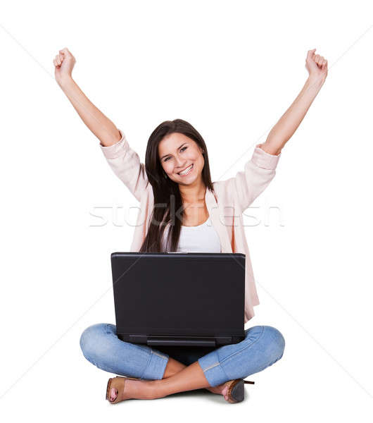 Woman sitting rejoicing with her laptop Stock photo © AndreyPopov
