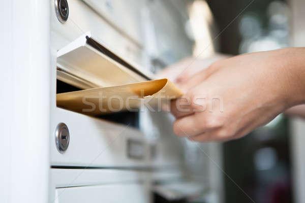женщину конверт почтовый ящик стороны Сток-фото © AndreyPopov