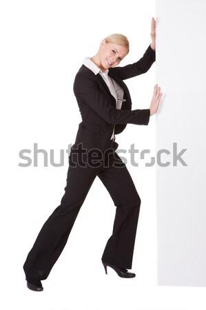 Uomo spingendo cartellone ritratto bianco Foto d'archivio © AndreyPopov