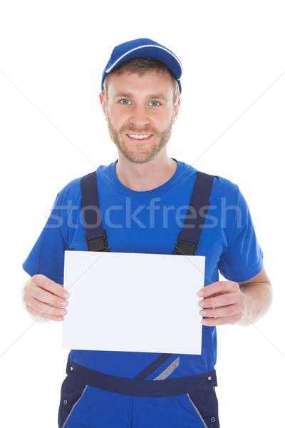Confident Male Servant Holding Blank Placard Stock photo © AndreyPopov
