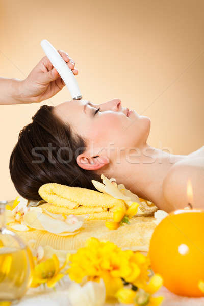 Woman Receiving Microdermabrasion Therapy On Forehead At Spa Stock photo © AndreyPopov