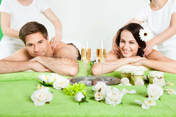 Happy Couple Receiving Shoulder Massage At Beauty Spa Stock photo © AndreyPopov