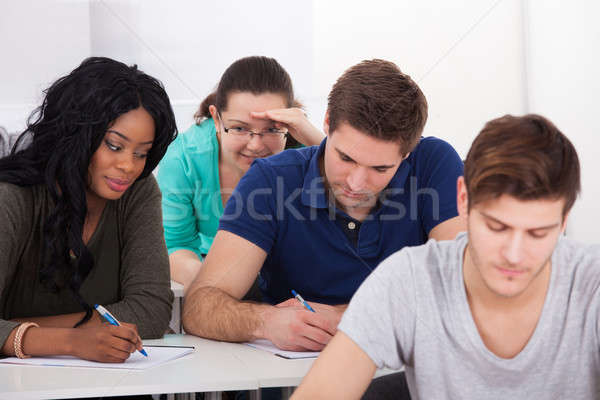 Female Students Trying To Cheat During Test Stock photo © AndreyPopov