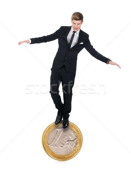 Businessman Balancing On One Euro Coin Stock photo © AndreyPopov