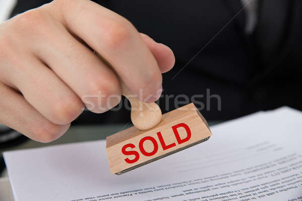 Hand Stamping Document With Sold Rubber Stamp Stock photo © AndreyPopov