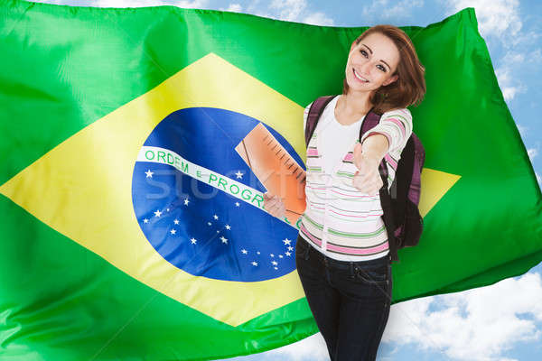Brazilian Student Gesturing Thumb Up Stock photo © AndreyPopov