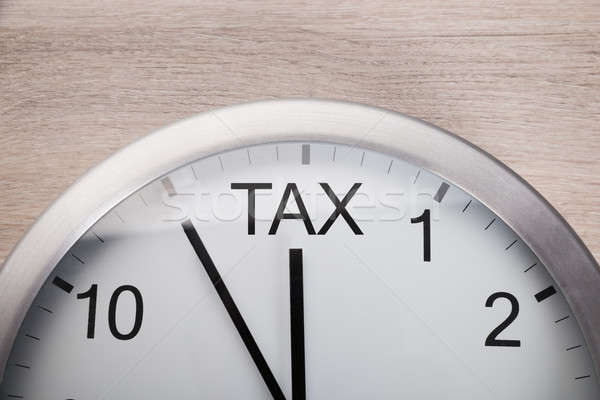 Clock Showing Arrival Of Tax Time Stock photo © AndreyPopov