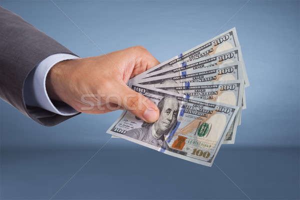 Hand holding paper currency Stock photo © AndreyPopov