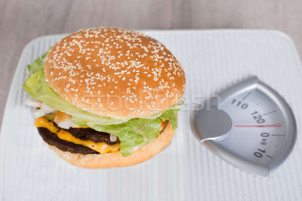 Hamburger On Weighing Scale Stock photo © AndreyPopov