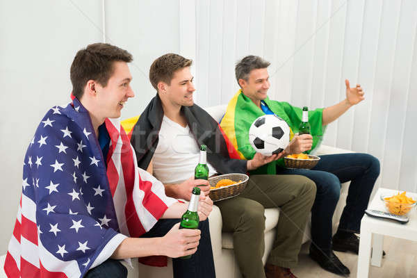 Friends Of Different Nation Supporting Football Team Stock photo © AndreyPopov