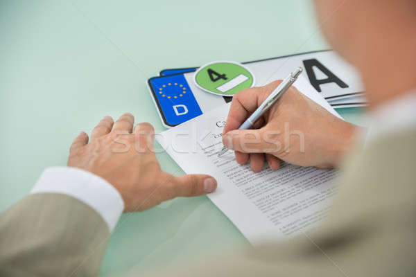 Businessman Filling Car Sale Contract Form Stock photo © AndreyPopov