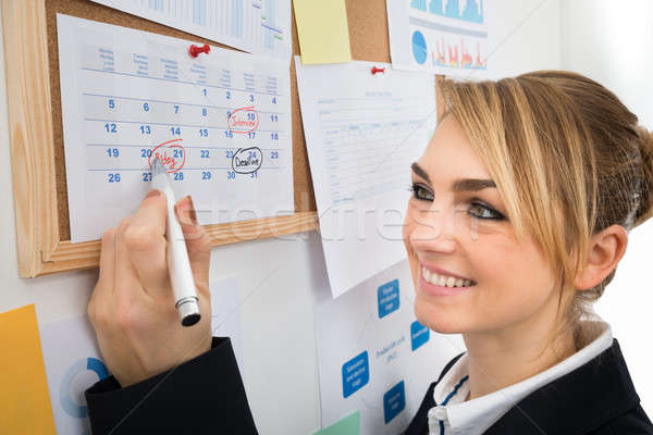 Businesswoman Marking Birthday On Calendar Stock photo © AndreyPopov