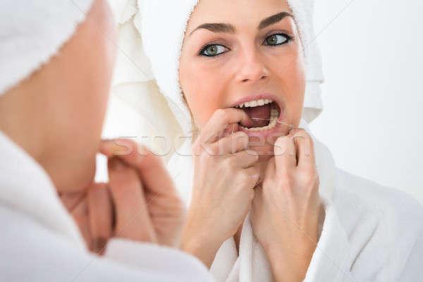 Сток-фото: женщину · зубов · глядя · зеркало · здоровья