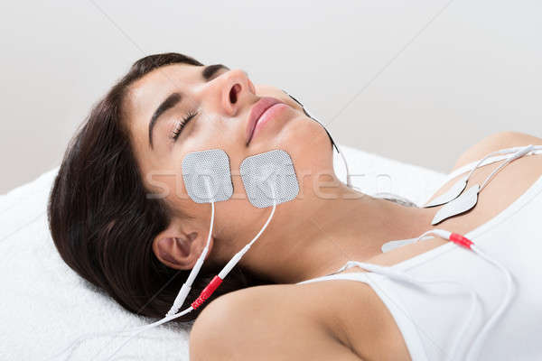 Woman With Electrodes On Her Face Stock photo © AndreyPopov