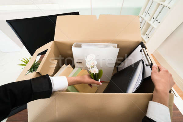 Businesswoman Packing Personal Belonging In Box Stock photo © AndreyPopov