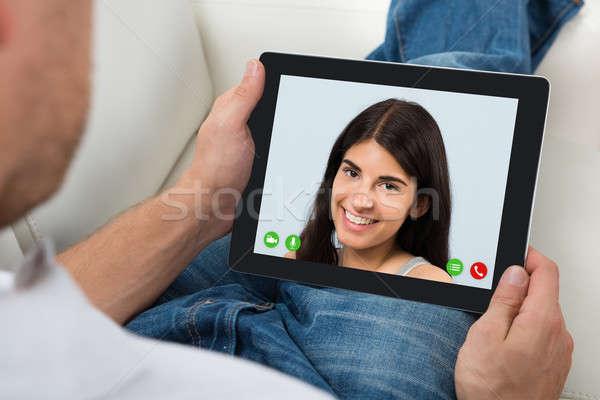 Person Videochatting With Woman On Digital Tablet Stock photo © AndreyPopov