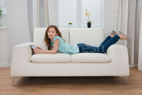 Girl With Digital Tablet In Living Room Stock photo © AndreyPopov