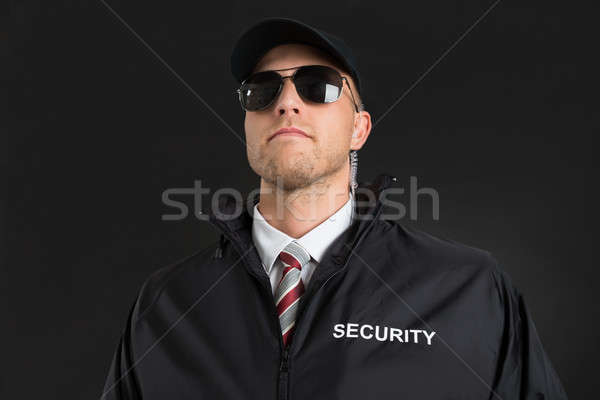 Bodyguard Wearing Sunglasses And Earpiece Stock photo © AndreyPopov