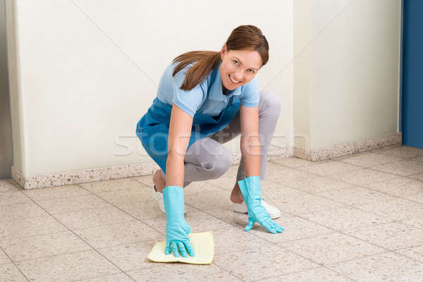 Janitor Cleaning Floor With Rag Stock photo © AndreyPopov
