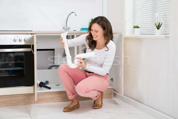 Woman Holding Plastic Pipe Stock photo © AndreyPopov