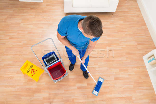 Worker Mopping Wooden Floor Stock photo © AndreyPopov